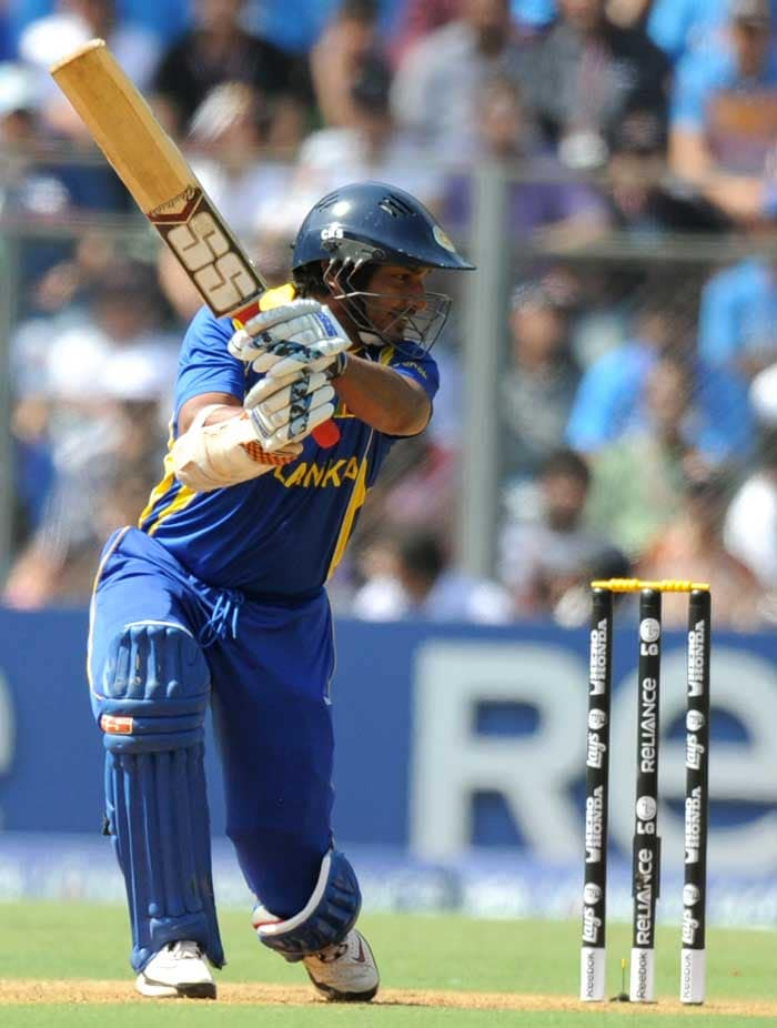 Sri Lankan batsman Kumar Sangakkara plays a shot during the ICC Cricket World Cup final match between India and Sri Lanka at Wankhede Stadium. (AFP Photo)