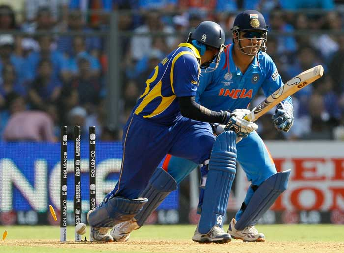 Tillakaratne Dilshan could not carry on the good work as he was bowled by Harbhajan Singh. (AP Photo)
