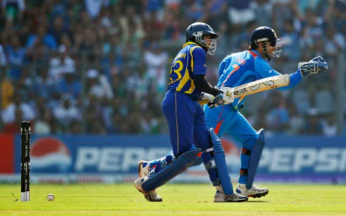 Indian's captain Mahendra Singh Dhoni celebrates the wicket of Sri Lanka's Tillakaratne Dilshan. (AP Photo)