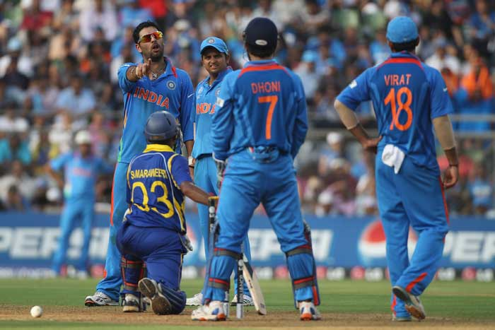 Yuvraj Singh picked up Thilan Samaraweera, a wicket that had its share of drama as well. Simon Taufel gave the initial decision in the batsman's favour, but Yuvraj was confident that he had his man trapped in front of the wicket. (AFP Photo)
