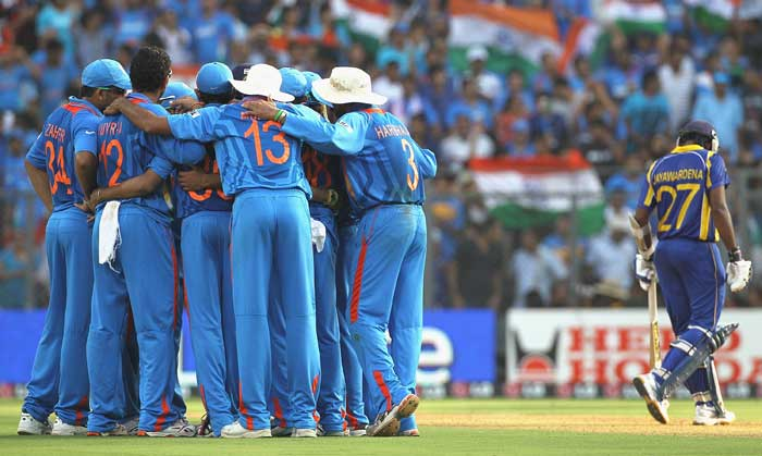 The Indian team huddle after the wicket of Thilan Samaraweera. (Getty Images)