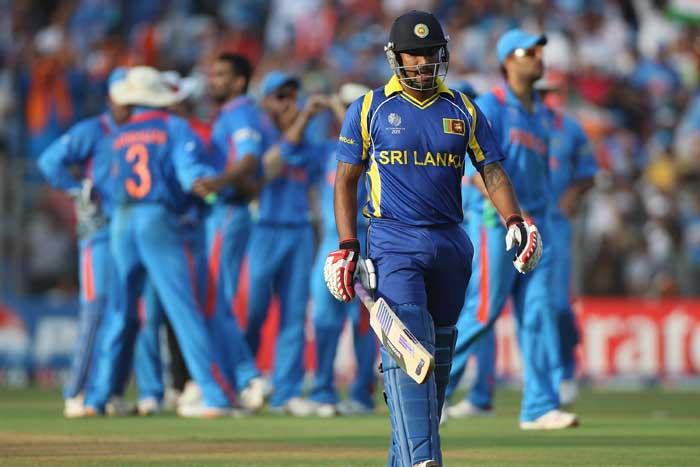 Indian team celebrates as Chamara Kapugedera walks back after being dismissed. (Getty Images)
