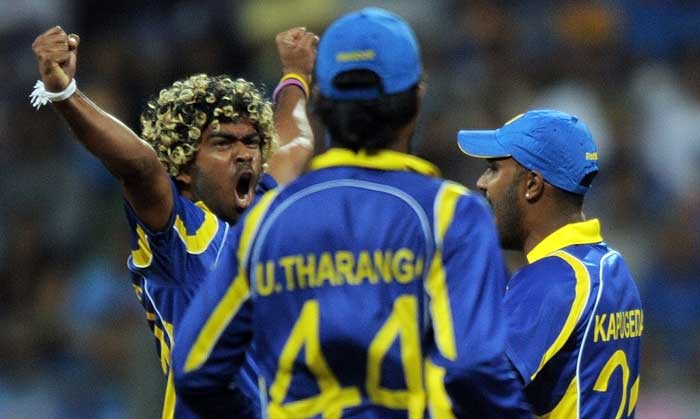 It was a short break because of the duration of the first innings and Sri Lanka started where they had left from. Lasith Malinga bowled a delivery that was quick and kept low to trap Virender Sehwag right in front of the wickets. (AFP Photo)