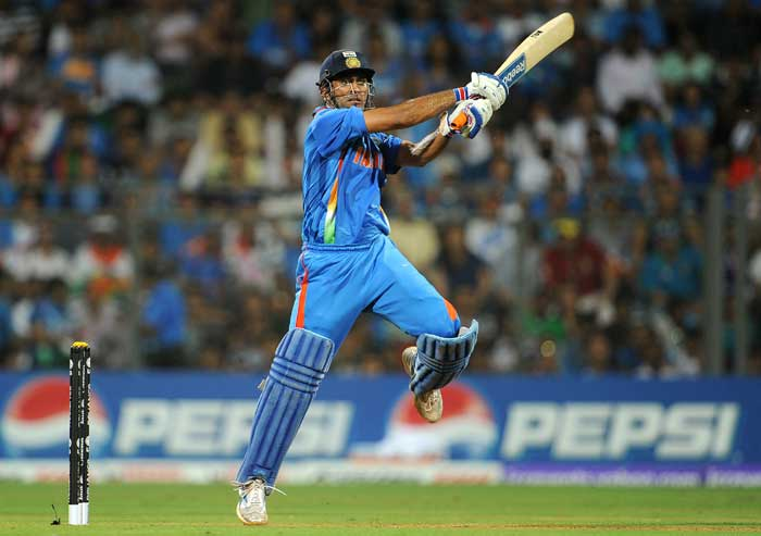 Indian skipper Mahendra Singh Dhoni scored a responsible fifty to take India close to the Sri Lankan total. (AFP Photo)