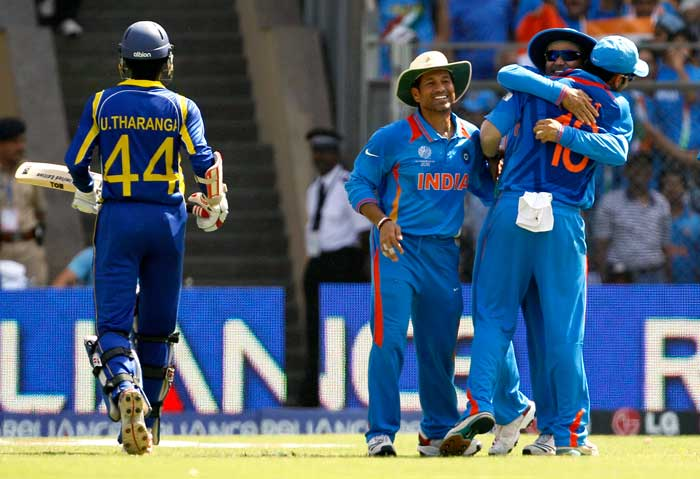 Indian players celebrate the wicket of Upul Tharanga. (AP Photo)