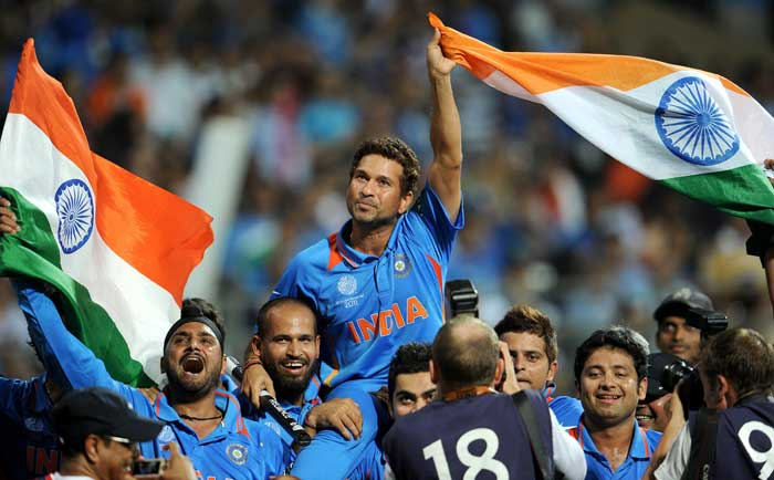 """<b>Simply, Sachin:</b> The Indian team puts to rest all debate on whether they played to win the World Cup for Sachin Tendulkar. Here, they hoist their hero on their shoulders for the victory lap. Virat Kohli later said, """"Tendulkar has carried the burden of the nation for 21 years, it is time we carried him on our shoulders"""". (AFP Photo)"""