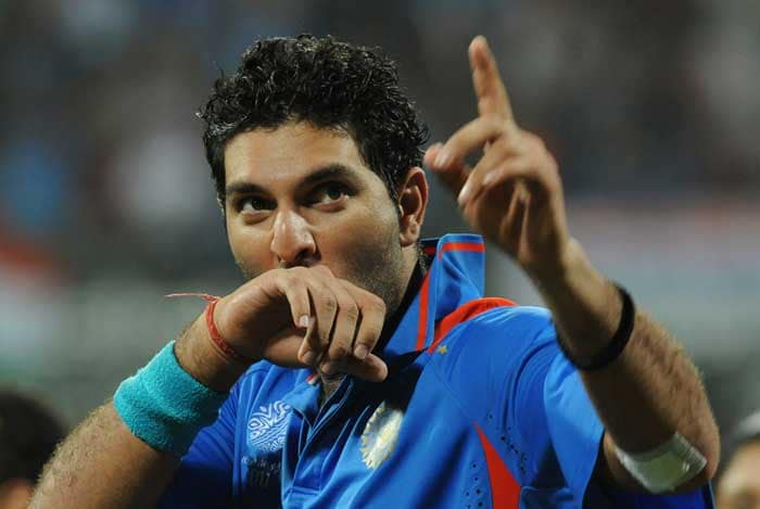 <b>A Prince's Kiss: </b>One for his fans as Yuvraj Singh acknowledges the crowds at Mumbai's Wankhede Stadium after being named Player of the Tournament. (AFP Photo)