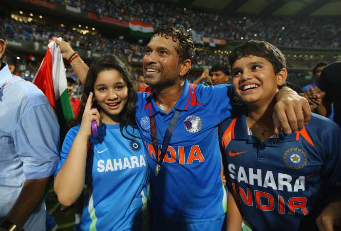 <b>Daddy Did It: </b>Sachin Tendulkar, the man they won it for, shares a moment of pure joy with his children, (AFP Photo)