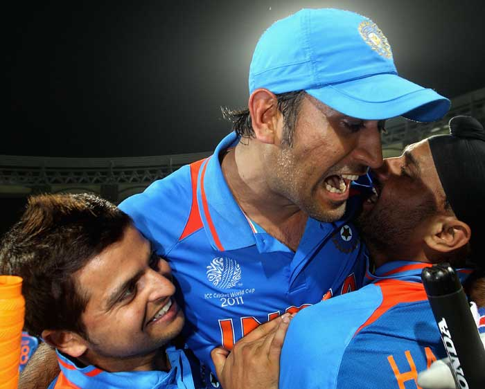 <b>My Captain: </b>Suresh Raina and Harbhajan Singh fete MS Dhoni, the man who has led them to some spectacular victories. And this once, straight from the front. (Getty Images)