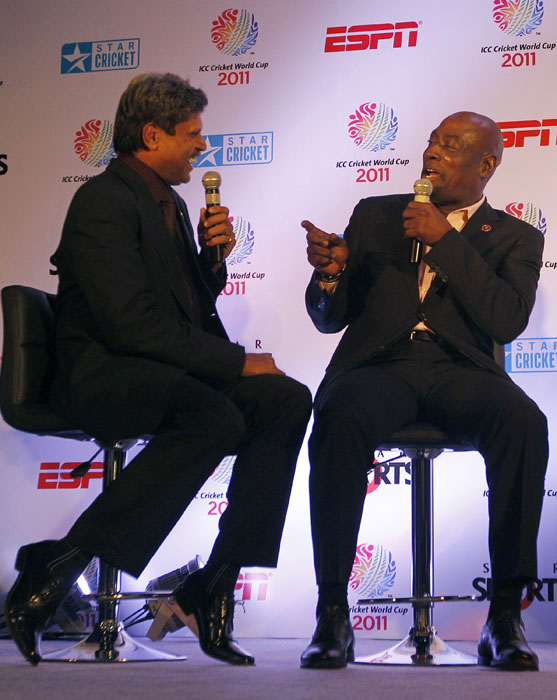 Kapil Dev and Vivian Richards share a joke during the ICC World Cup 2011 press conference and display of the World Cup 2011 trophy in New Delhi. (AP Photo)