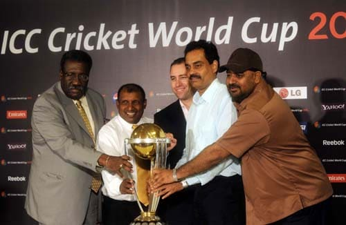 Former Test cricketers Clive Lloyd of West Indies, Arvinder de Silva of Sri Lanka, Michael Bevan of Australia, Dilip Vengsarkar of India and Balwinder Singh Sandhu of India pose with the ICC Cricket World Cup 2011 trophy during the unveiling ceremony in Mumbai. (AFP Photo)
