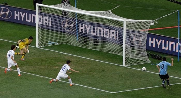 """With both teams locked at 1-1 in the Round of 16 encounter between Uruguay and South Korea and the match looking destined for extra time, Suarez after receiving a pass from the corner cut inside and struck an absolute screamer which would surely go down as one of best goals scored in South Africa. <br><br><a href=""""http://ndtv.footballindia.com/2010_worldcup/fan_survey.aspx"""" class=""""fg fn fl fs12"""">Pick your best goal</a>"""