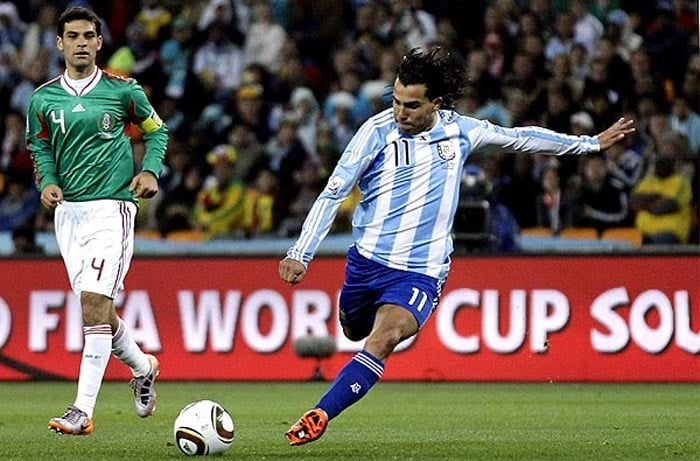 """The Mexicans suffered a lot of heartburn due to the first two goals scored by Argentina in the Round of 16 fixture, but this one was a piece of magic from the Manchester City striker.<br><br> Tevez attempted to wriggle into space and latched onto a rebound, well outside the area. Hitting the ball on the turn first time, it lashed past Perez and into the top corner before the keeper could barely move. <br><br><a href=""""http://ndtv.footballindia.com/2010_worldcup/fan_survey.aspx"""" class=""""fg fn fl fs12"""">Pick your best goal</a>"""