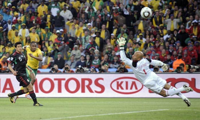 """With home fans rallying behind them in the World Cup opener against Mexico, the 'Bafana Bafana' boys made more than a match out of the encounter. The highlight of the match was definitely the superb strike by South African mid-fielder Siphiwe Tshabalal who put the hosts in front.<br><br> Tshabalala was picked out on the break by a long raking ball and he fired a thunderbolt of a shot into the far top corner, leaving the Mexican keeper with absolutely no chance. The crowd went absolutely wild as the hosts took an unlikely lead and South Africa's hopes of qualification seemed like a reality. <br><br><a href=""""http://ndtv.footballindia.com/2010_worldcup/fan_survey.aspx"""" class=""""fg fn fl fs12"""">Pick your best goal</a>"""