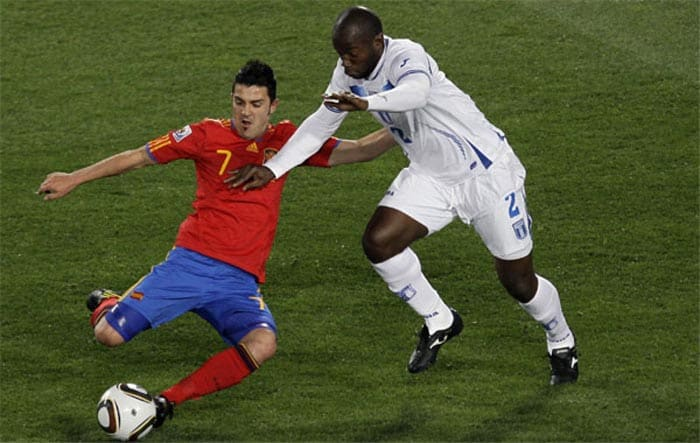 """Having lost their opening encounter against the Swiss, the Spanish were up against it as they faced the determined Honduras. With the clock ticking by and anxiety rising, David Villa decided to show some individual brilliance and calmed the Spanish nerves.<br><br> Villa had been scintillating out on the left flank and he did brilliantly to beat four Honduras defenders on a slaloming run in from the touchline before curling a shot into the top corner, via the fingertips of the goalkeeper. It was a wonderful, wonderful goal and a fitting way for Spain to begin their World Cup account. <br><br><a href=""""http://ndtv.footballindia.com/2010_worldcup/fan_survey.aspx"""" class=""""fg fn fl fs12"""">Pick your best goal</a>"""