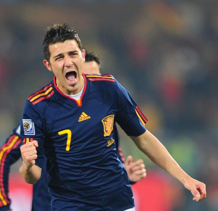 """David Villa can very easily be termed as 'lucky feet', not to take anything away from the striker, but such is the now Barcelona man's prowess that he seems to find the net from the most unlikely of opportunities.<br><br> With Spain needing a win against Chile, Villa opened the scoring in the 23rd minute when Chilean keeper Bravo decided to commit hara-kiri. He came out for the ball and missed it. Villa who was lurking around, took control of the ball and let fly a first timer in the empty net to put Spain infront. <br><br><a href=""""http://ndtv.footballindia.com/2010_worldcup/fan_survey.aspx"""" class=""""fg fn fl fs12"""">Pick your best goal</a>"""
