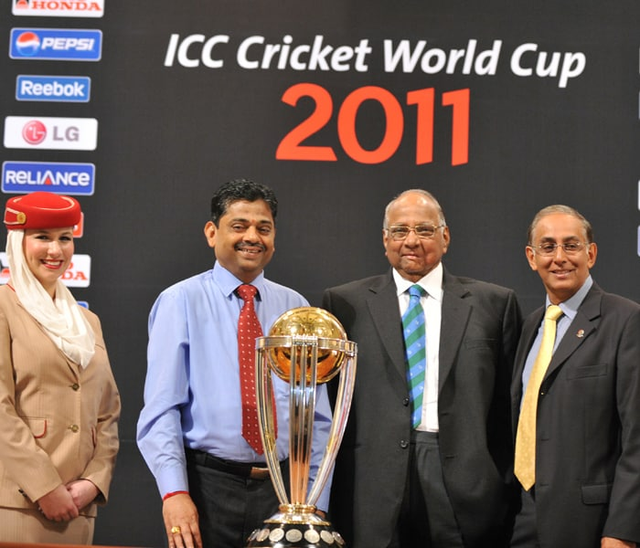 Sharad Pawar, President of the International Cricket Council (ICC), ICC Chief Executive Haroon Lorgart (2nd R), and ICC 2011 World Cup Director Ratnakar Shetty (2nd L) pose with the 2011 World Cup trophy. (AFP Photo)