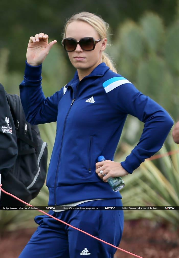 Seeded 10th in the Australian Open, Denmark's Caroline Wozniacki failed to go past the third round. <br><br>The 23-year-old player though quickly bounced back from her defeat by joining fiance Rory McIlroy where the golfer is playing Abu Dhabi HSBC Golf Championship. <br><br>All images courtesy AFP.