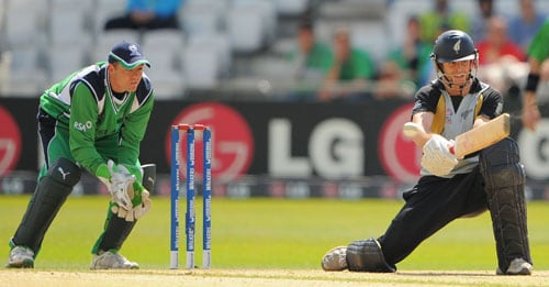 Aaron Redmond sweeps the ball for 4 runs past Gary Wilson during the ICC World Twenty20 match at Trent Bridge in Nottingham. (AFP Photo)