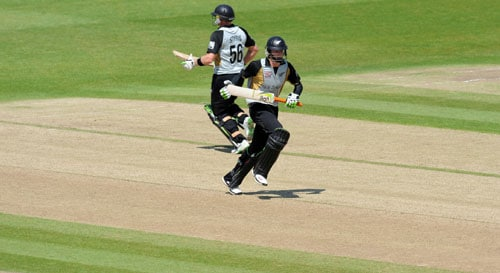 Scott Styris and Martin Guptill run between the wickets against Ireland during the ICC World Twenty20 match at Trent Bridge in Nottingham. (AFP Photo)