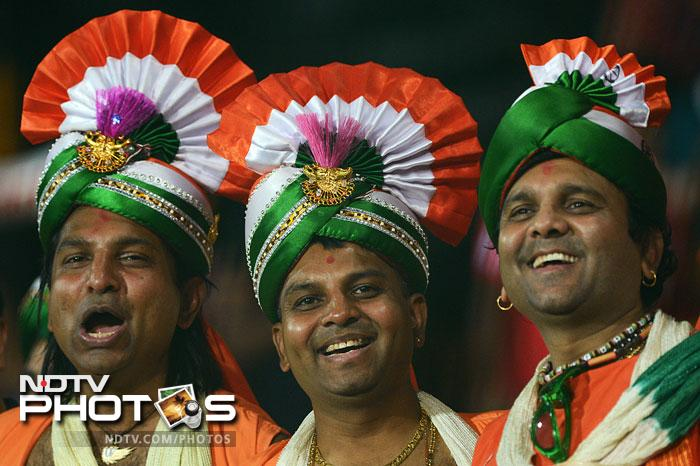 Indian fans cheer during the ICC World Twenty20 match between India and England at the R. Premadasa Stadium in Colombo. (AFP Photo)
