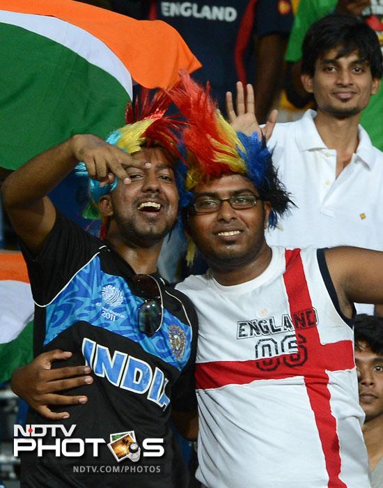 India and England fans cheer during the ICC World Twenty20 match between England and India at the R. Premadasa Stadium in Colombo. (AFP Photo)