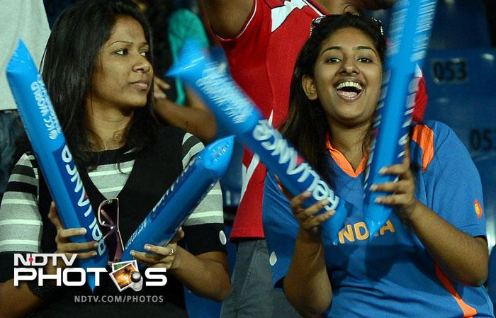 India fans cheer during the ICC World Twenty20 match between England and India at the R. Premadasa Stadium in Colombo. (AFP Photo)