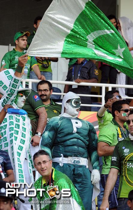Pakistan fans cheer during the ICC World Twenty20 match between Pakistan and New Zealand at the Pallekele International Cricket Stadium in Pallekele. (AFP Photo)