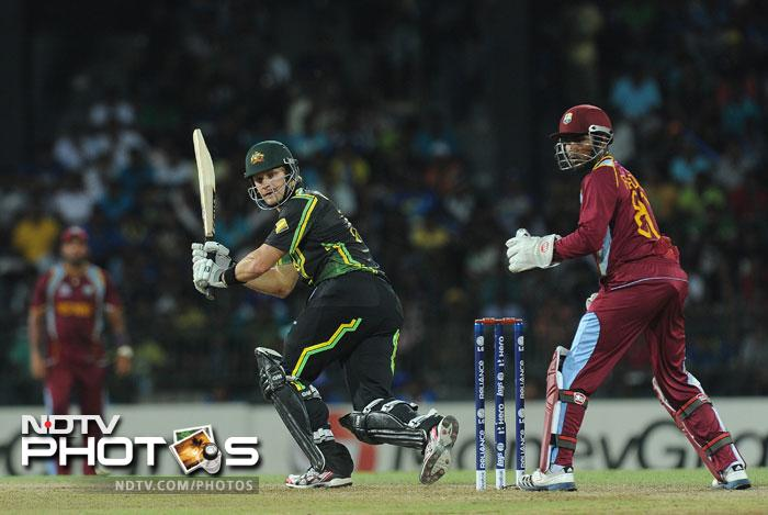 Shane Watson picked up the mantle after Warner's departure and was looking in sublime form in his unbeaten 41 from 24 balls which included 3 huge sixes. This time it was the Windies bowlers who were running for cover.