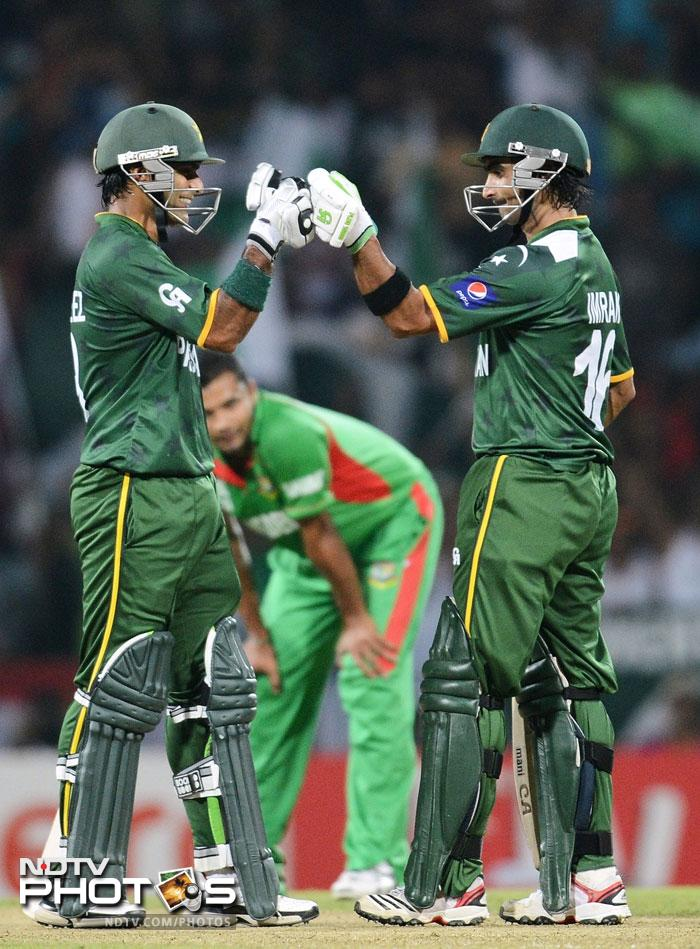 Pakistan booked their Super Eight berth after they handed Bangladesh a demoralising defeat by 8 wickets in Pallekele. A look at the match where the bat dominated the ball. (All Photos AFP)