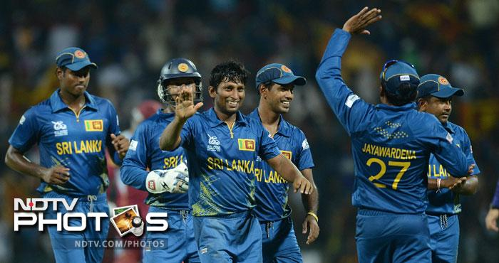 Sri Lanka showed no sign of nerves after their narrow win against New Zealand as they trounced the West Indies by 9 wickets to virtually seal a place in the semis. It was a complete performance by the hosts and they hardly gave an inch to the Windies. (All AFP Photos)
