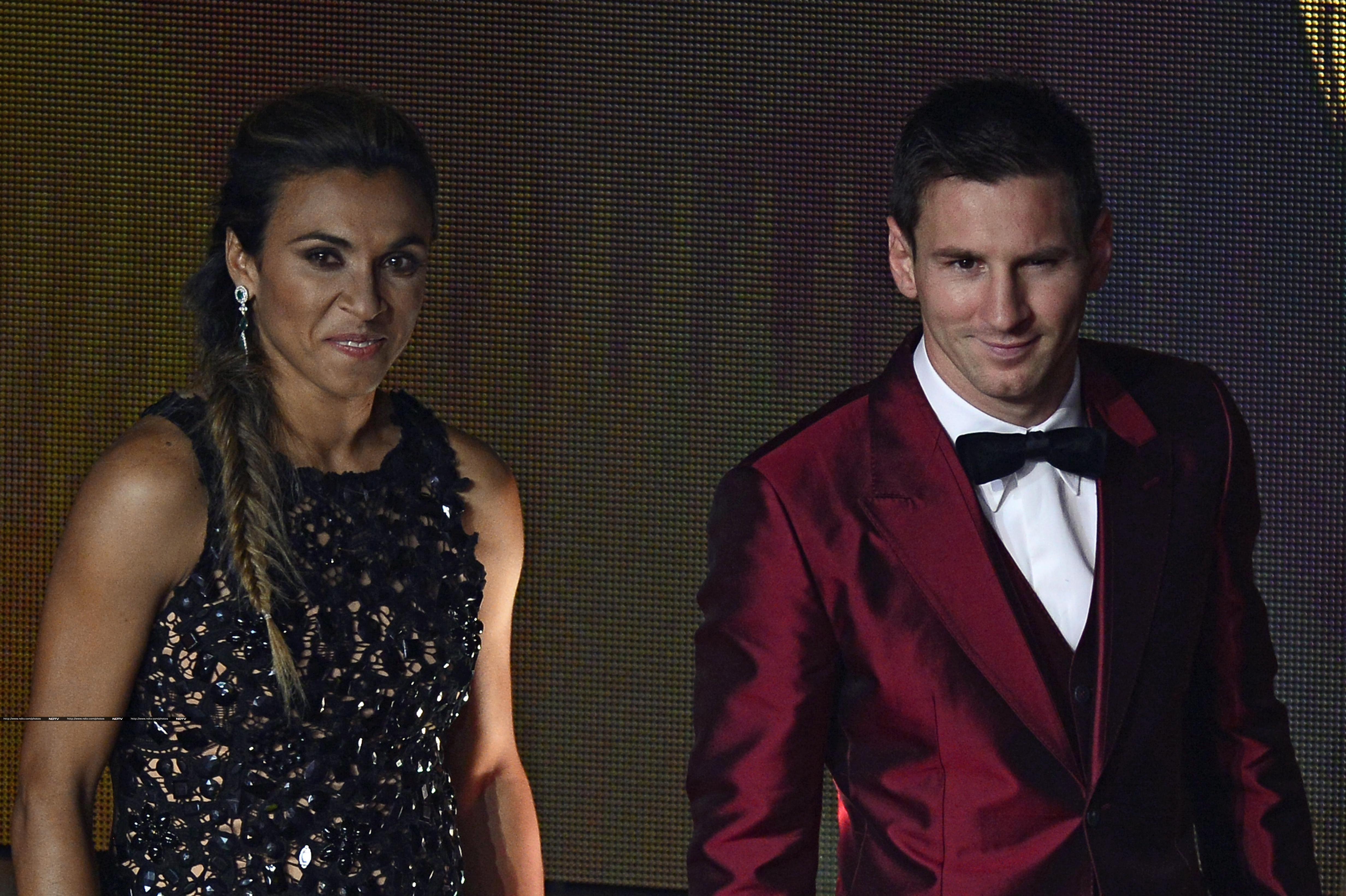 While every player and official on stage opted to don the 'mundane' blue or black suits, Messi chose to go for a bright red tuxedo. (AP and AFP photos)