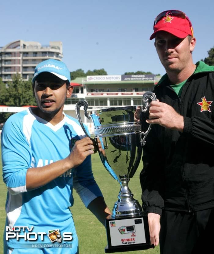 Zimbabwe skipper Brendan Taylor and Bangladesh captain Mushfiqur Rahim share the trophy after the series ended in a 1-1 draw.