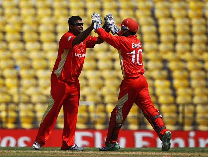 Balaji Rao congratulates Ashish Bagai, after he caught Craig Ervine during the 2011 ICC World Cup Group A game between Canada and Zimbabwe at Vidarbha Cricket Association Ground in Nagpur, India. (Getty Images)