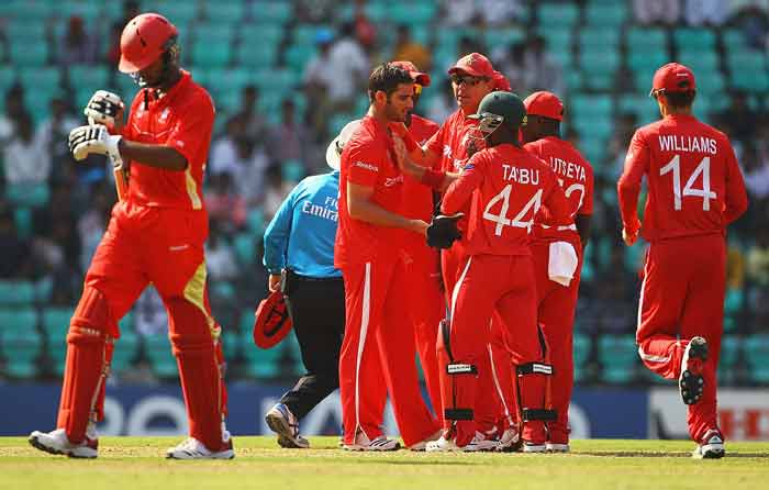 Greg Lamb is congratulated by teammates, after bowling Ruvindu Gunasekera during the 2011 ICC World Cup Group A game between Canada and Zimbabwe at Vidarbha Cricket Association Ground in Nagpur, India. (Getty Images)