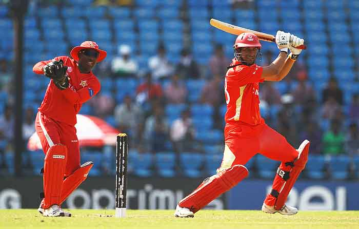 Jimmy Hansra hits the ball towards the boundary, as Tatenda Taibu looks on during the 2011 ICC World Cup Group A game between Canada and Zimbabwe at Vidarbha Cricket Association Ground in Nagpur, India. (Getty Images)