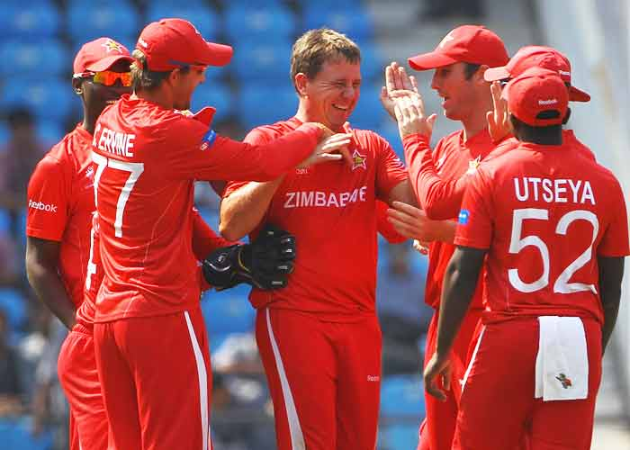 Ray Price of Zimbabwe is congratulated on the wicket of Nitish Kumar of Canada during the 2011 ICC World Cup Group A game at Vidarbha Cricket Association Ground in Nagpur, India. Zimbabwe beat Canada by 175 runs. (Getty Images)