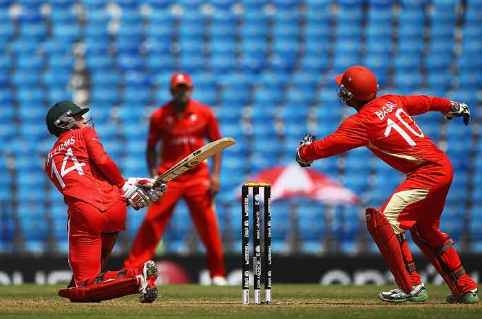 Sean Williams looks to hit out, but is caught by Ashish Bagai during the 2011 ICC World Cup Group A game between Canada and Zimbabwe at Vidarbha Cricket Association Ground in Nagpur, India. (Getty Images)