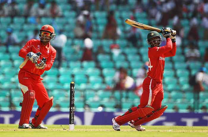 Tatenda Taibu hits the ball towards the boundary, as Ashish Bagai looks on during the 2011 ICC World Cup Group A game between Canada and Zimbabwe at Vidarbha Cricket Association Ground in Nagpur, India. (Getty Images)