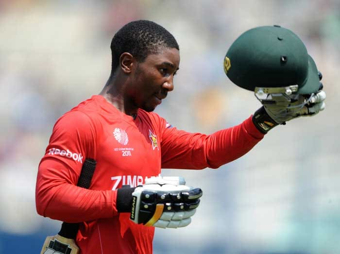 Zimbabwe batsman Tatenda Taibu takes his helmet off as he returns to the pavilion after being dismissed. (AFP Photo)