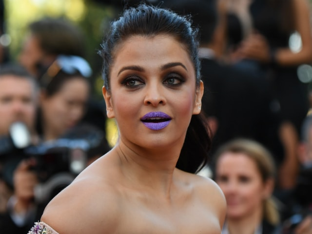 Abhishek Describes Aishwarya's Purple Pout in One Word