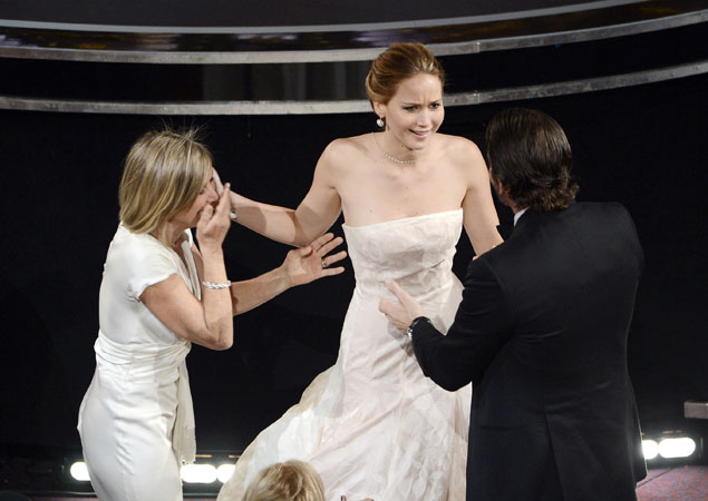 In pictures jennifer lawrence s epic fall at the oscars