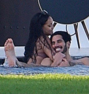 Rihanna Cosies Up To Mystery Man