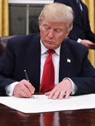 Donald Trump Signs His First Executive Order On Obamacare