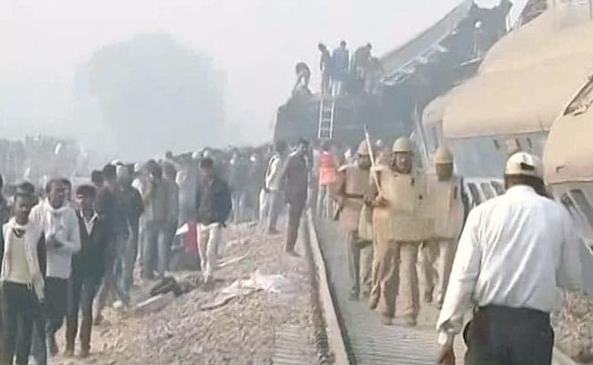 Train derails in north India, killing 63 and trapping others