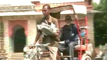 Video : Child strapped to rickshaw puller's chest critical; govt steps in