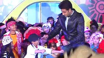 Video : Abhishek's baby's day out without Aaradhya