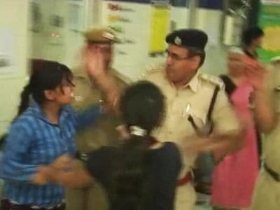 Video : Watch woman protester at Delhi hospital slapped by cop