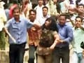 Video : Clashes outside Odisha assembly: Protestors thrash woman cop