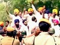 Protesters march towards PM's residence against Sajjan Kumar's acquittal